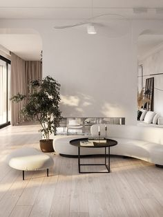 An elegant minimalist living room with a curved sofa and a matching footrest. It comes plus a black round coffee table. Apartment Interior, Interior Design Living Room, Living Room Decor, Design Bedroom, Minimalist Interior, Minimalist Living, Minimalist Furniture, Minimalist Decor, Modern Minimalist