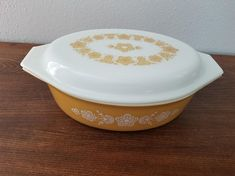Pyrex Butterfly Gold Casserole with Matching Lid - 045 - has 1 small chip on the under side of one handle as shown in the picture. Still has shine and has just minor wear/scratching. Measure - X - no incl handles - 13 Handle to handle - Tall Pyrex Bowls, Butterfly Gold, Vintage Pyrex, Casserole, Chips, Anchor Glass, Tableware, Etsy, Kitchen