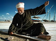 An Egyptian old man make sail for a boat   This photograph was taken in front of Borolos lake which located in Kafr El-Sheikh , Egypt  Sail Maker by Sayed Abd Algalil on 500px