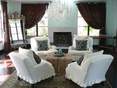 Brown and Blue  RMS user rachelcar created a calm but cozy living room with a symmetrical arrangement of chairs and dramatic chocolate-brown draperies that elegantly frame the fireplace.