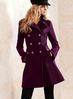 Straight long coat w/ some flair and pockets at the hips