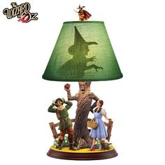Limited-edition WIZARD OF OZ™ lamp features sculpted haunted forest scene. Custom lamp shade boasts WICKED WITCH™ silhouette and finial.