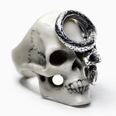 Inspired by the infernal aesthetics of the dark side, this handmade ring from Macabre Gadgets is a unique piece that adds drama to any look.