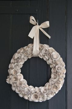 This beautiful wreath is crafted from sweet paper blooms