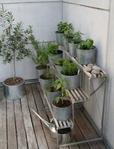 Metal pots and pans. I like the shelving idea more than anything. very modern.