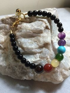"7"" Onyx Chakra Bracelet with Gold Plated Lobster closure by AlisonsGemstones on Etsy"