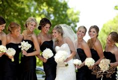 love the contrast of the white florals with the black bridesmaids dresses!
