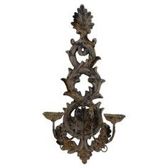 "Bring stately style to your hall or foyer with this ornate candle sconce, featuring a scrolling acanthus leaf design and brown finish.  Product: Candle sconceConstruction Material: CeramicColor: BrownFeatures: Ornate scrollworkAccommodates: (2) Candles - not includedDimensions: 29"" H x 14"" W x 7"" D"