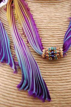 shibori silk - Google keresés.  Idea:  Crochet on either side of a large bead.