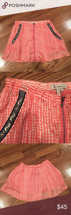 BCBGeneration skirt size xs Coral polkadot fabric with embellished pockets and zipper down the front. Very cute! Skirt is 13 inches long. BCBGeneration Skirts A-Line or Full
