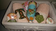 Set of towels with candle and soaps in a basket. Teacher gift