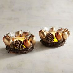 Need a centerpiece idea? Done! Gather several of our autumn-inspired tealight holders and place them in a line down the center of your table. Each is crafted of natural pinecones, lifelike acorns, twigs and even a touch of glitter. It's also pretty at a party in a covered outdoor space, weather permitting.