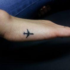 tiny plane tattoo
