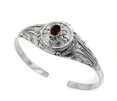 """Sterling Silver Genuine Garnet Locket Box Poison Cuff Bracelet Silver Insanity. $149.97. Secret Compartment Opens!. Genuine 6x8mm Oval Garnet. Fits a 7"""" to 8"""" Wrist. Weight is 21.5 Grams. 7/8"""" Wide in the Center"""