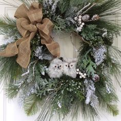 Winter Wreath-Snowy Owl Wreath-Christmas Wreath for Front Door-Country Wreath-Reginas Garden Owl Wreath-Wreaths-Snowy Evergreen Wreath  A sweet pair of snowy owls rests in the center of a full and lush snow-covered wreath. Lots of realistic evergreen boughs, including white pine, cedar, hemlock and juniper give this wreath a natural woodsy look. Snow-covered branches, evergreens, berries and pine cones add loads of winter charm. A simple burlap and tan plaid bow finishes the look, making it…
