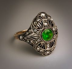 Art Deco Russian Demantoid Ring | From a unique collection of vintage dome rings at http://www.1stdibs.com/jewelry/rings/dome-rings/