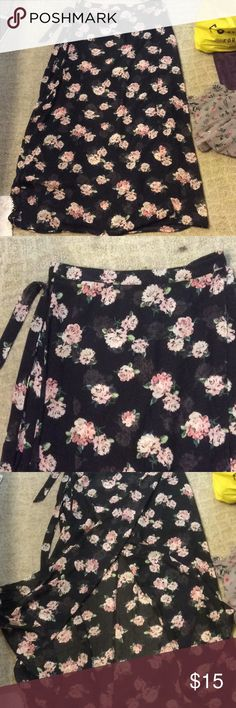 Black floral print skirt Black skirt with pick and green flowers. Has a tie at waist. Has a slit opening on one side. Has short black underskirt. Forever 21 Skirts Maxi