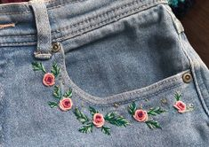 r/crafts - Jazzing up some old denim shorts, I did this on the other pocket too! - bity pink flowers on denim. Informationen zu r/crafts – Jazzing up some old denim shorts, I did th - Flower Embroidery Designs, Simple Embroidery, Hand Embroidery Patterns, Diy Jean Embroidery, Diy Clothes Embroidery, Skirt Embroidery, Jeans With Embroidery, Denim Jacket Embroidery, Halloween Embroidery