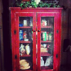 Lightly distressed vintage red pie safe