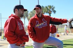 Cardinals pitchers Jaime Garcia (left) and Adam Wainwright talk as they watch live batting practice during St. Louis Cardinals spring training on Sunday, Feb. 17, 2013, at Roger Dean Stadium in Jupiter, Fla. Photo by Chris Lee, clee@post-dispatch.com