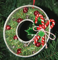 """Isa Creative Musings: Ornaments - Donut shaped tin filled with greenery and vintage ornaments/beads create a mini """"wreath"""" ornament Vintage Christmas Crafts, Christmas Ornament Crafts, Vintage Ornaments, Retro Christmas, Rustic Christmas, Holiday Crafts, Christmas Holidays, Christmas Things, Alternative Christmas Tree"""