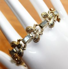 Damascene Toledo Gold Coloured Bows & Mother of Pearl Bracelet with Safety Chain (c1950s) by GillardAndMay on Etsy