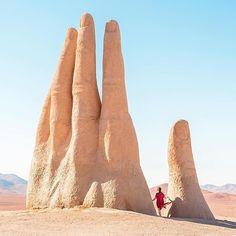 Mano del Desierto, a sculpture by Chilean artist Mario Irarrázabal in the desolate Atacama Desert of Chile.