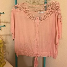 🔴Light Pink Blouse Brand new. Tag attacher is still on, but tag isn't. Ties at bottom. Lace on top. Solitaire Tops Blouses