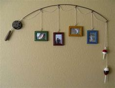 up-cycled fishing poles  Could do this with old bats and the kids' ball pictures!  I never know how or where to display those.