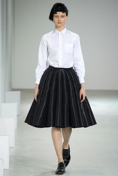 This skirt and vlouse combo from Junya Watanabes Fall 2015 RTW collection is similar to the skirts and blouses worn by women in the late 1940's. With a pleated skirt about shin to knee length, and a casual and clean looking blouse up top this is a style that derives directly from the late 40's. Although Junya Watanabes impression of the late 40's style is a little darker and more stiff, its still hold key similarities in the pleated skirt and the lightweight casual shirt.  Feb 23rd, 2017