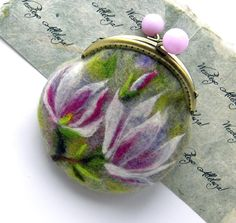 This is a hand felted purse that I have individually designed Felted coin purse with bag frame metal closure . Decor - needlefelted FLOWER Magnolia.