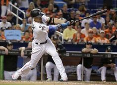 New sultan of swat: Stanton's year won't be forgotten  -  October 2, 2017:    Miami Marlins' Giancarlo Stanton hits a RBI single to score Tyler Moore during the fifth inning of a baseball game against the Atlanta Braves, Sunday, Oct. 1, 2017, in Miami. (AP Photo/Lynne Sladky)