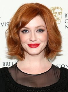 Christina Hendricks Christina Hendricks's long bob is full of volume, and her bright red hue gives it added oomph.