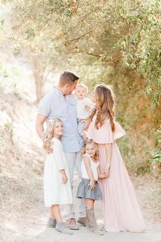 Love the pink & blue color combination in their outfits. Perfect for spring & summer family pictures Family Photo Colors, Family Picture Poses, Family Picture Outfits, Family Photo Sessions, Family Posing, Family Photography Outfits, Family Portrait Outfits, Family Portraits, Kid Photography Poses