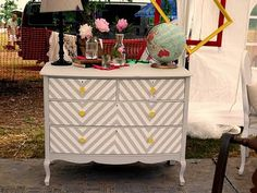 Chevron dresser. I would change the handles from yellow to gray or turquoise.
