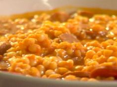 Get this all-star, easy-to-follow Portuguese White Beans recipe from Emeril Lagasse