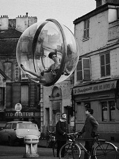 """Bubbles in Paris, 1963 Melvin Sokolsky: Sokolsky was a major figure in the revival of fashion photography from the 1960s. He was only 21 when he started working at Harper's Bazaar for which he produced the """"Bubble"""" series of photographs depicting fashion models floating in giant clear plastic bubbles suspended in midair above the Seine river in Paris. Alongside his steady collaboration with Bazaar"""