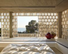 """archatlas: """" The Lattice House in LlafrancThe Lattice House by Lopez-Rivera Architects is situated in a pine forest with a steep slope descending to the south and overlooking the bay of Llafranc."""