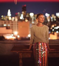 Carolyn Murphy models knit sweater and sequined skirt from Anthropologie's November 2017 catalog