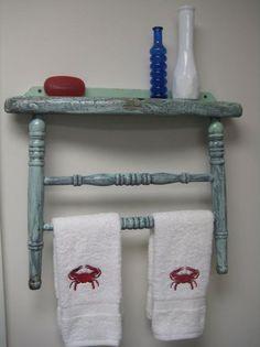 Old chair back, reused as a towel rack.