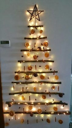tree DIY Wall Christmas Tree Ideas That'll Get You To Downsize Now - Hike n Dip Looking for Christmas decoration for small space. Then you should definetly put up a wall Christmas Tree. Here are best DIY Wall Christmas tree ideas. Driftwood Christmas Tree, Wall Christmas Tree, Indoor Christmas Decorations, Christmas Tree Toppers, Christmas Tree Ornaments, Christmas Lights, Modern Christmas, Rustic Christmas, Christmas Diy