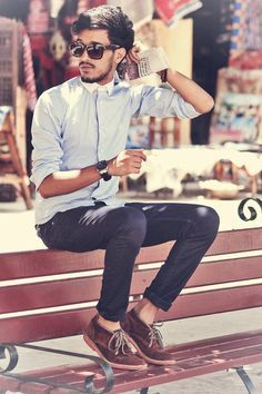 Men's Fashion | Light Blue Button-Up, Sunglasses, Dark Navy Jeans, Watch, Suede Shoes. CASUAL