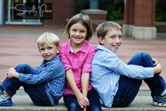 This is a great family pose idea for 3 kids. The middle child is squished between her two brothers.she needs to be moved forward. Family Picture Poses, Family Photo Sessions, Family Posing, Family Pictures, Picture Ideas, Photo Ideas, Kid Photos, Children Photography Poses, Family Portrait Photography