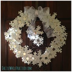 Snowflake Wreath ~ After spending too much time Googling and Pinterest-ing in a quest for a creative spark, I stumbled upon a puzzle piece snowflake ornament. I took this concept a step further by creating a puzzle piece snowflake wreath. Let's put the pieces together…