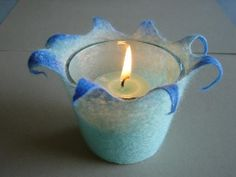 For candle holders - put a glass inside felted cover.
