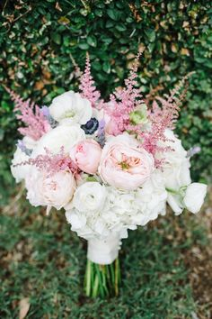 Billowy romantic wedding bouquet in a soft blushe palette accented by gooseneck   Classic Southern Charleston Wedding At Dunes West Golf & River Club   Photograph by Aaron and Jillian Photography  http://storyboardwedding.com/southern-charleston-wedding-dunes-west-golf-river-club/