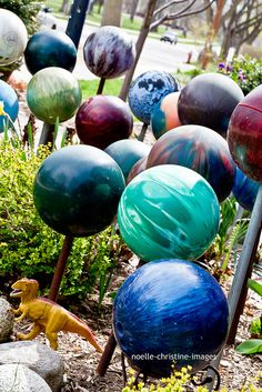 bowling ball garden art- I love how these are on posts. I have mine all lined up as border along a flower bed.