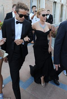 Shady couple: Scarlett and her boyfriend Romain Dauriac arrived in sunglasses to the Palazza del Cinema