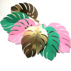 * Handmade in Australia * Set the scene for your tropical party with paper monstera leaves. Pink, green and gold collection. Choose: 12 x Large Leaf shapes (3 colours, 4 each) each shape approx 23cm x 16cm or 20 x Medium Leaf shapes (7 pink, 7 green, 6 gold) each shape approx 18cm x