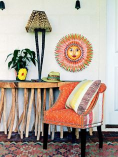Floral curtains and a chair covered in Kemp's 'Book End' and 'Inside Out' fabrics for Christopher Farr pick up the pink of the decoupage artwork, by Biarritz-based artist Mimi. Atop the writing desk is a coconut plant pot, complete with cheeky monkey, while at its base sits a vibrant mochila bag woven by the Wayuu people of Colombia.